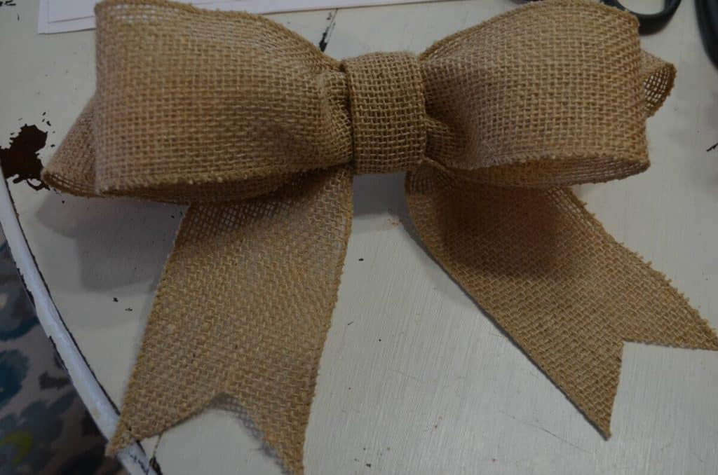 Burlap ribbon tied for grapevine spring wreath