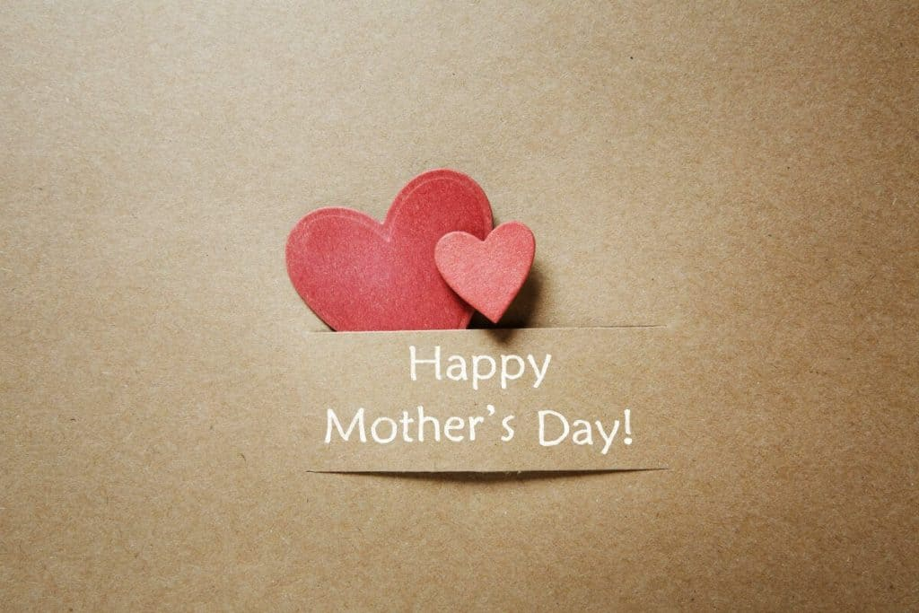 """Front of a greeting card with hearts and a """"Happy Mother's Day"""" caption"""