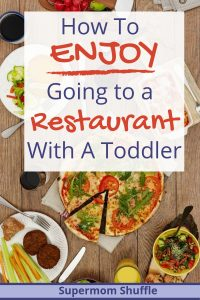 "Wooden table with lots of food dishes with caption ""How to Enjoy Going to a Restaurant With A Toddler"""