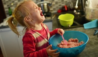 toddler girl crying over bowl of food