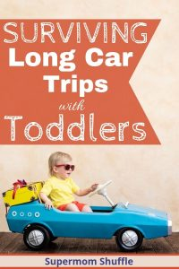 "Toddler with sunglasses in a blue pedal car with a toy suitcase tied on the back with title ""Surviving Long Car Trips with Toddlers"""
