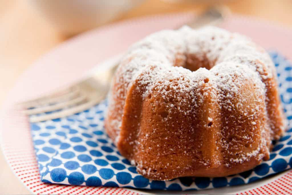 Lemon Pound Cake with Powdered Sugar Topping on a blue napkin