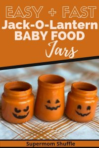 Babyfood jars painted to look like jack-o-lanterns on a whte and orange plaid tablecloth