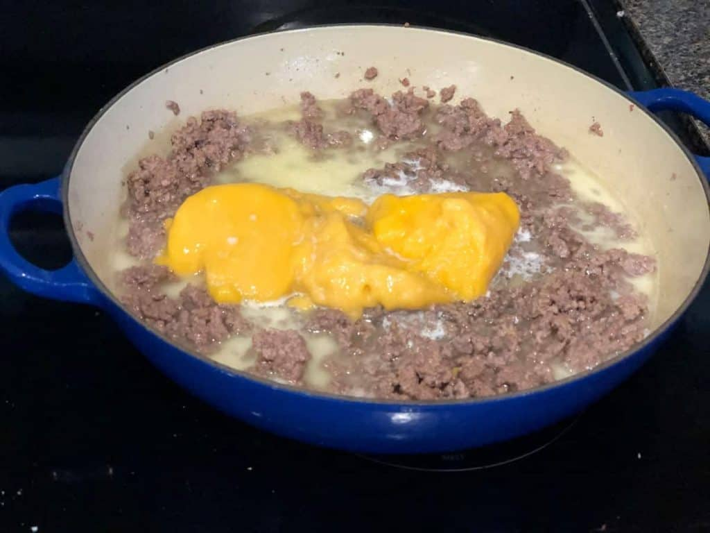 ground beef with cheddar cheese soup and milk on top