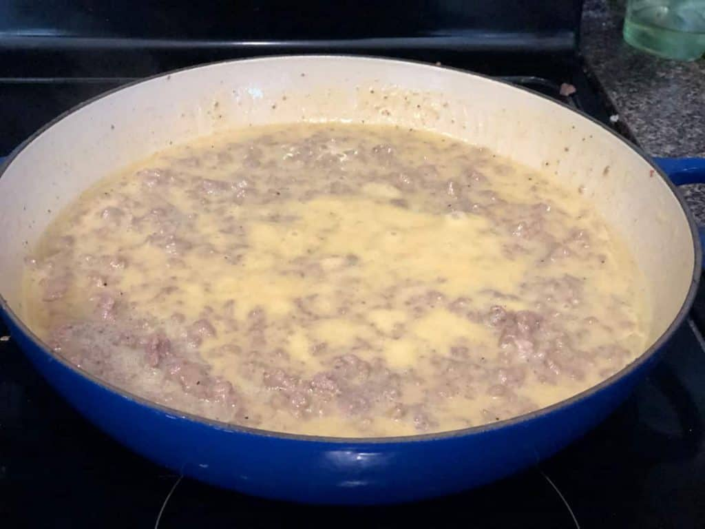 cheesy meat bake mixture simmering on stove