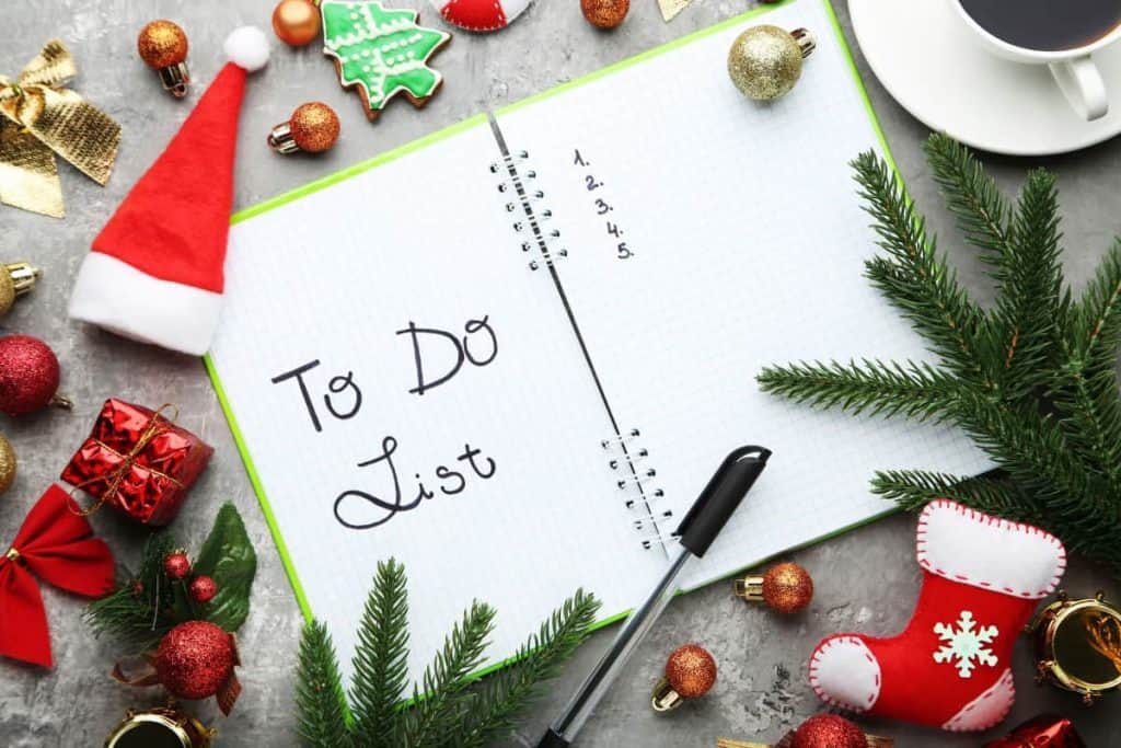 Christmas To-Do List with stockings and cookies and decorations scattered about