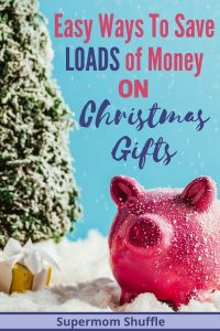 "Pink piggy savings bank with a Christmas Tree and gift in the background sitting in fake snow with a title of ""Easy Ways to Save Loads of Money on Christmas Gifts"""