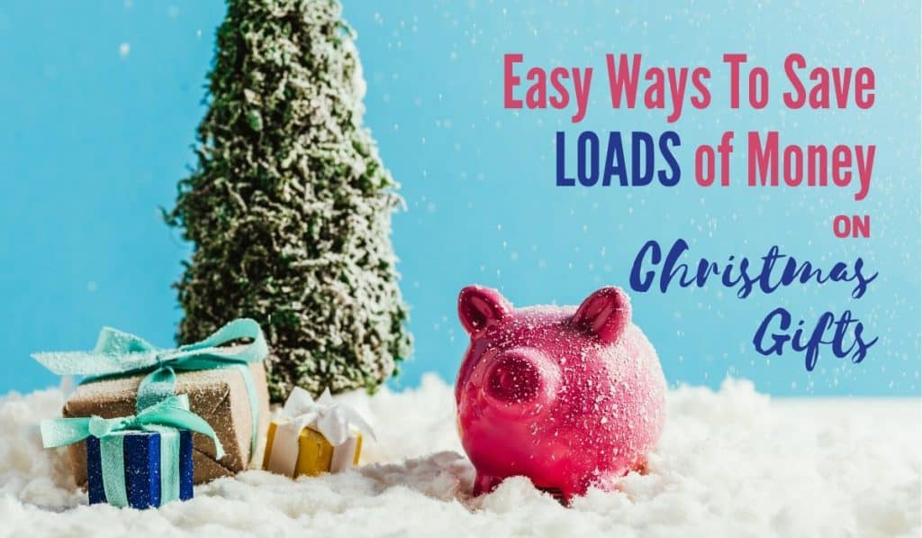 "Small artificial tree with gifts with fake snow sprinkled around and a pink savings bank pig with title of ""Easy Ways to Save Loads of Money on Christmas Gifts"""