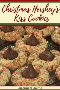 Christmas decorated hershey kiss peanut butter cookies on a glass plate