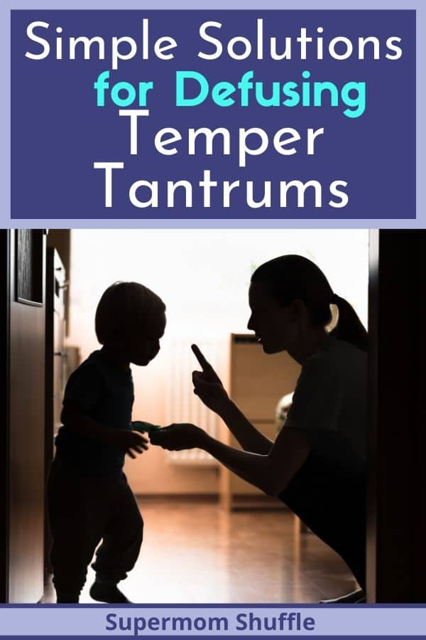 mom with toddler diffusing a temper tantrum