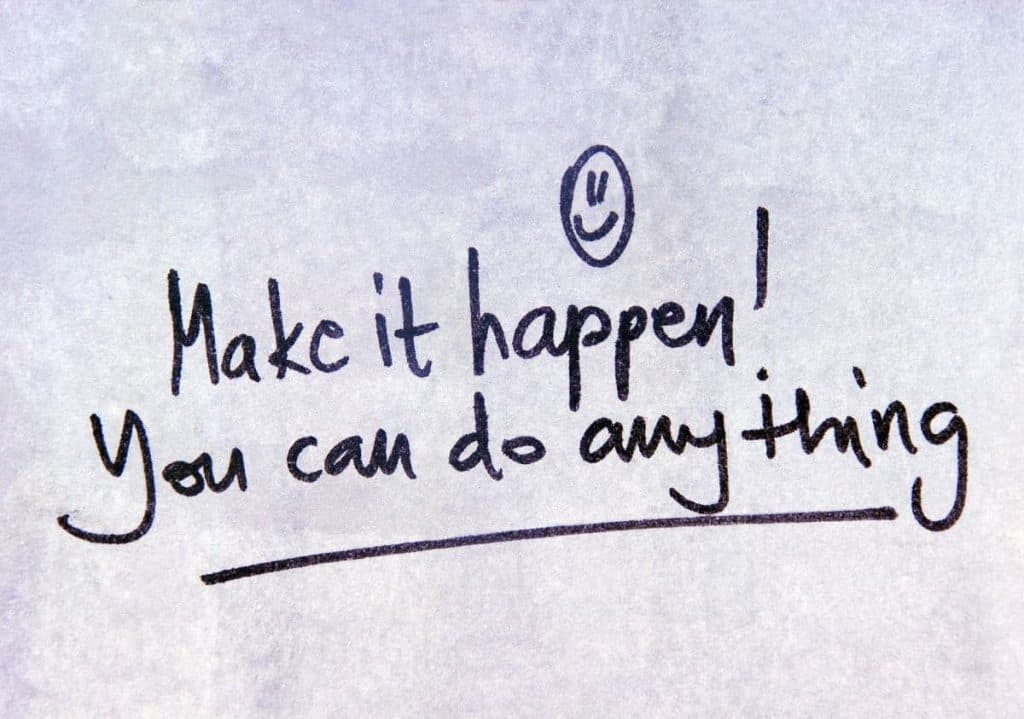 "handwritten note with smiley face saying ""make it happen! You can do anything!"""