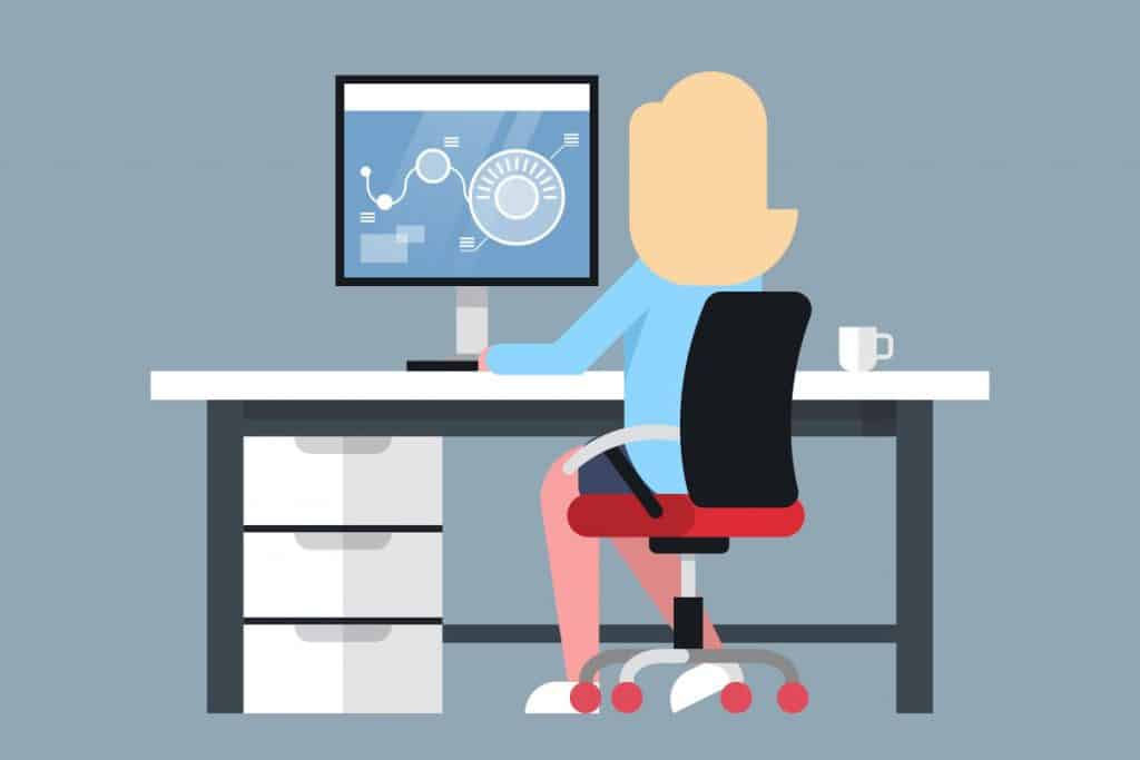 cartoon woman sitting at a computer on a desk