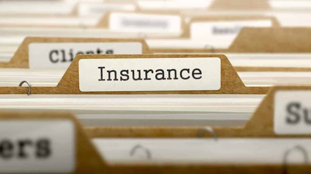 File folders filed with labels named insurance