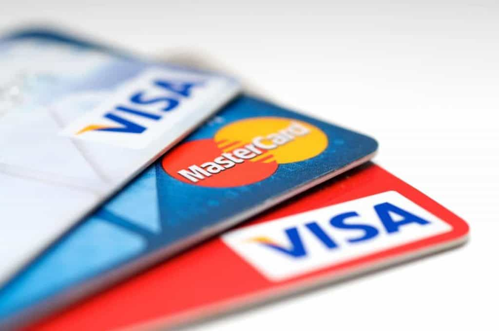 credit cards fanned out on desk during financial crisis
