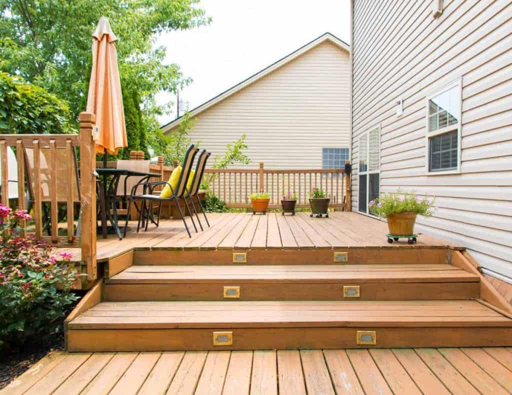 deck with table and flowers after spring home maintenance