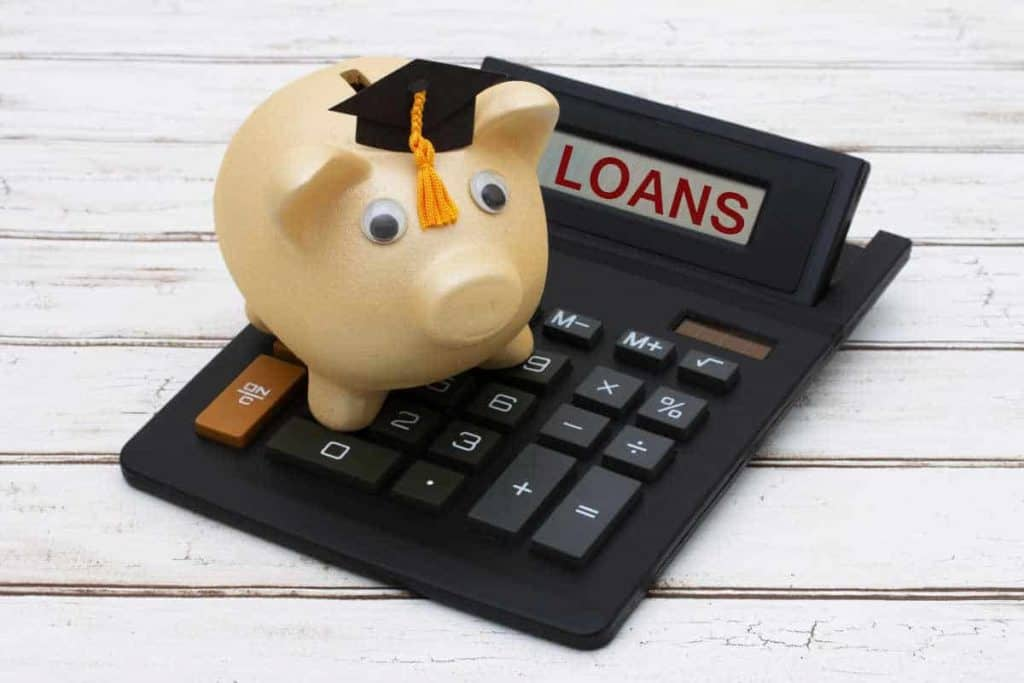 piggy bank with graduation cap on for student loans